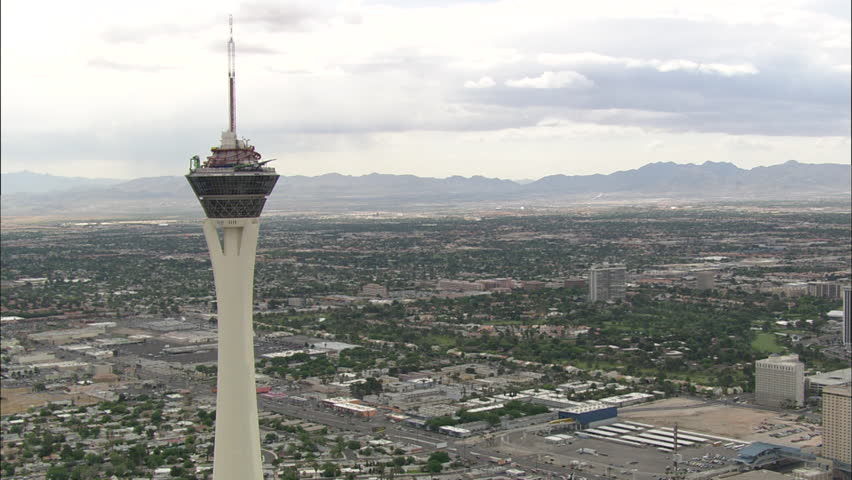 Las Vegas Space Needle. Shot of the top of the space needle in Las Vegas. The roller coaster of the top of the needle can be seen. Hotels and buildings can be seen in the background. - HD stock video clip