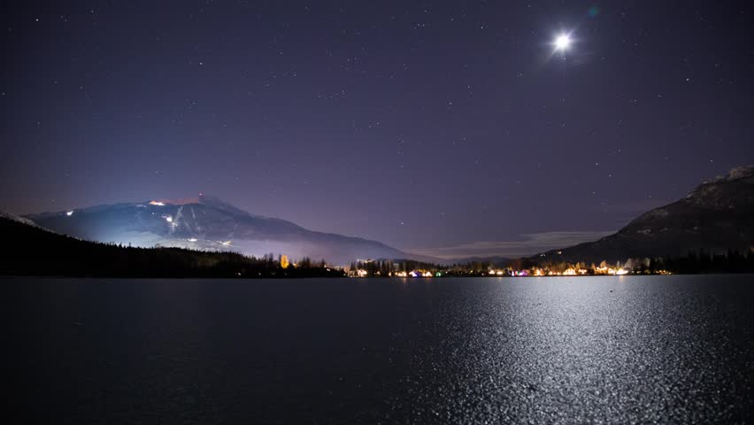 Time lapse 2 Shots of moonset on frozen Green Lake at Whistler, BC