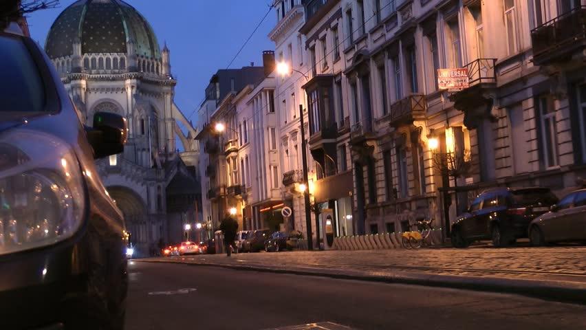 Trams, Buses, Cars - street view traffic Circa: February 2014: Rue Royal, Brussels, Belgium