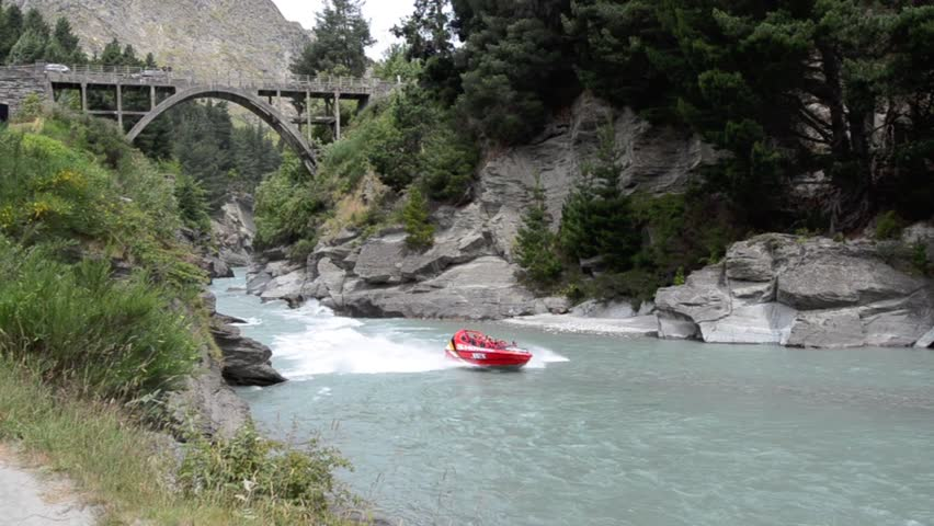 QUEENSTOWN, NZ - JAN 16:Tourists enjoy a high speed jet boat ride on the Shotover River on Jan 16 2014 in Queenstown, New Zealand. Queenstown is one of the most popular summer and winter resort in NZ. - HD stock video clip