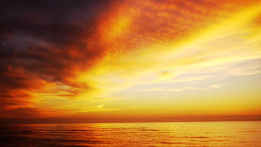 4K Time Lapse of Sunset Afterglow at Beach -Tilt Down-