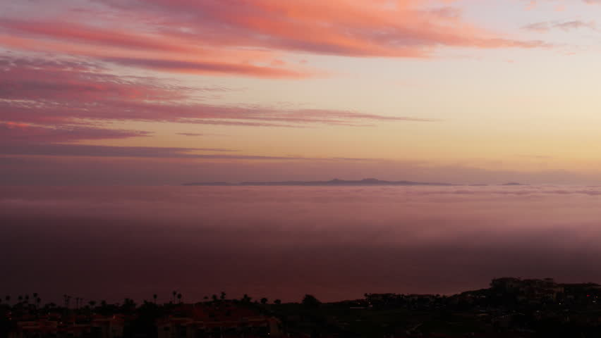 Time Lapse of Sunset Afterglow and Coastal Fog at Dusk -Tilt Up- - HD stock footage clip