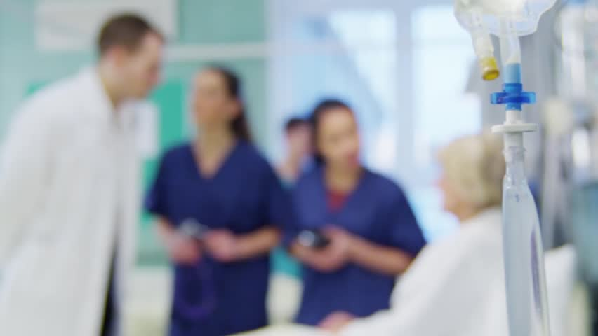 Medical staff working together and taking care of patients on a hospital ward.  | Shutterstock HD Video #5783138