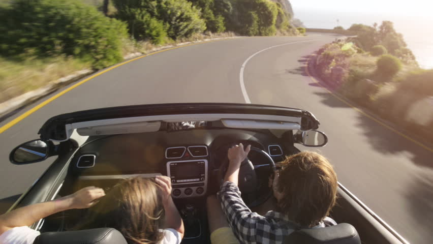Couple driving convertible car cabriolet cape town south africa steadicam shot