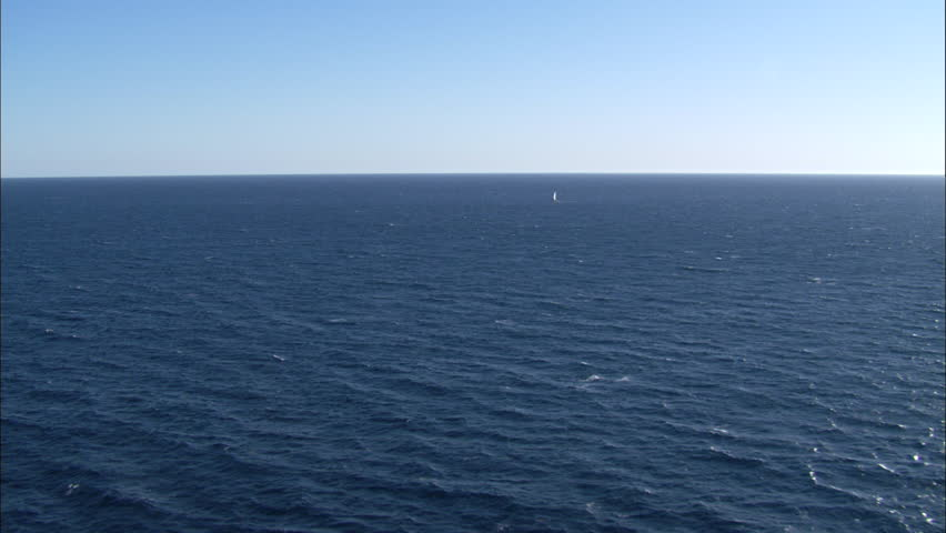 Ocean Boat Waves. A contrasting view of the ocean against the light blue sky. | Shutterstock HD Video #5794388