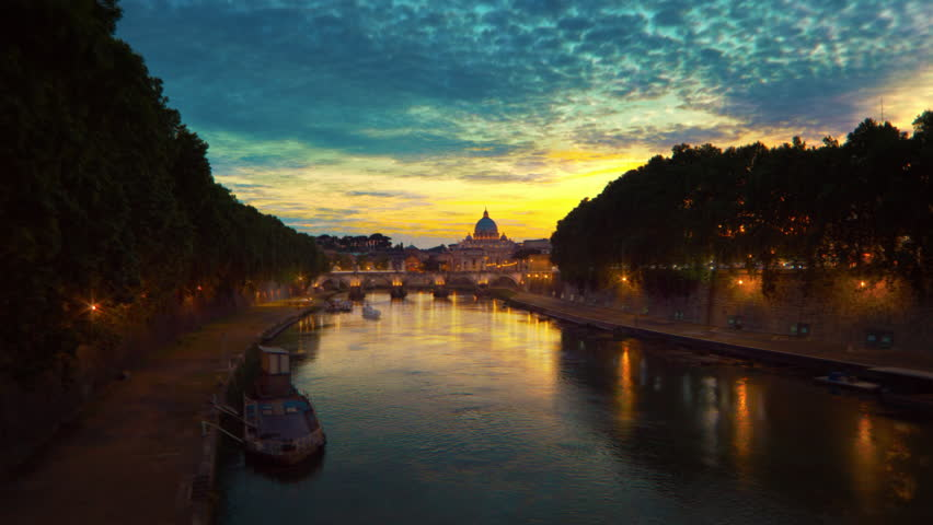 Vibrant sunset time-lapse of the Vatican City, from across the Tevere River
