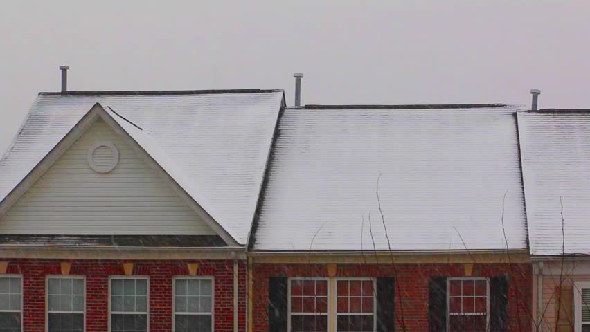 Wind Blowing On Building : Wind blowing snow mound on building rooftops stock footage
