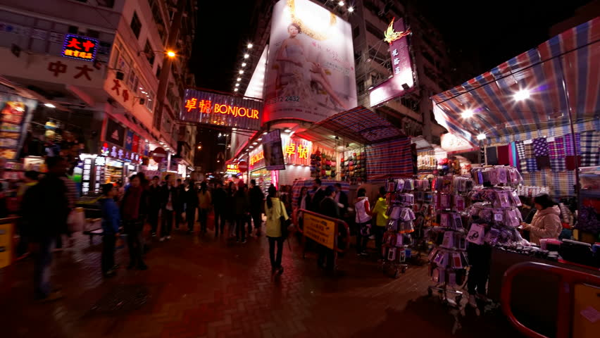 HONG KONG, SAR CHINA - JANUARY 19: World travelers enjoy colorful street night market time lapse  in Mong Kok, January 19, 2014, selling clothes, toys, electronics and accessories | Shutterstock HD Video #5819201