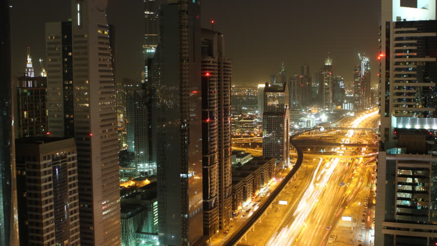 time lapse of busy streets and skyscrapers in dubai city