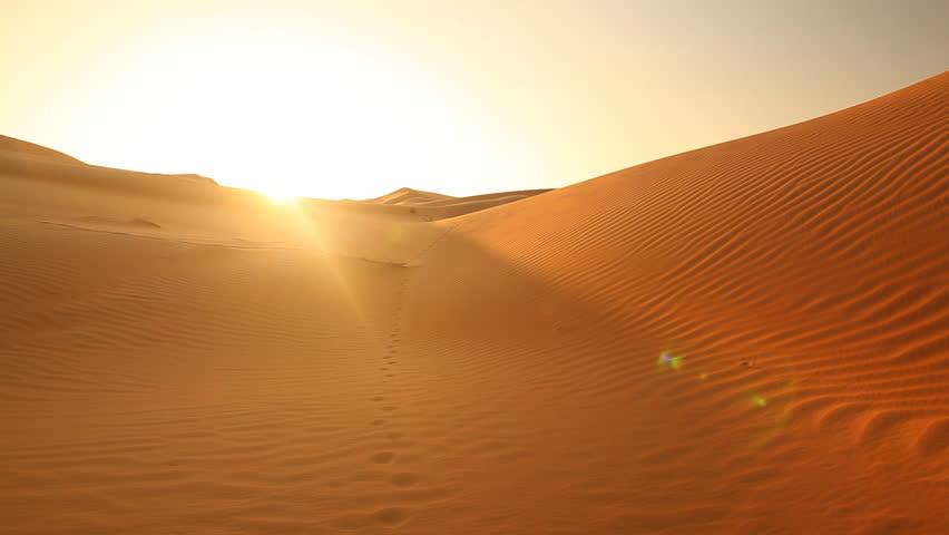 pan shot over beautiful sand dunes in sunset