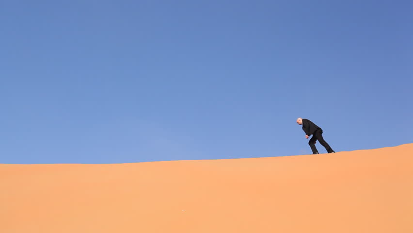 hopeless and weak businessman alone in desert - HD stock footage clip