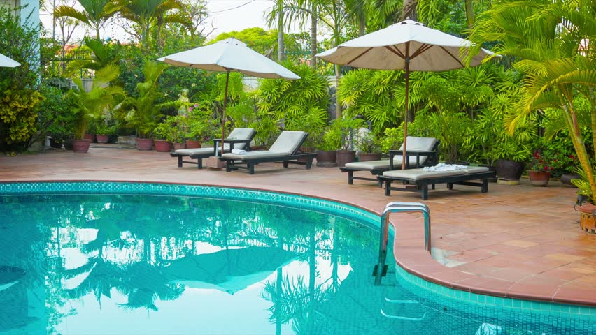 High definition video sunbeds and umbrellas around the pool at the hotel stock footage video - Define poolside ...