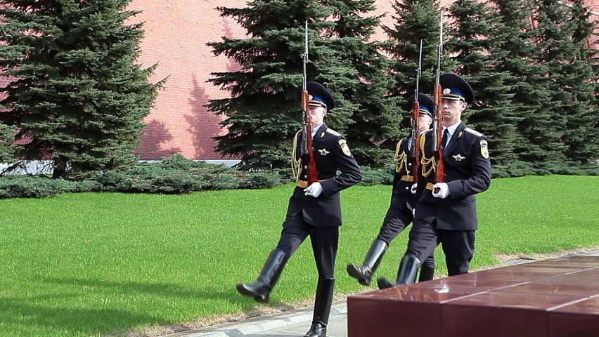 MOSCOW, RUSSIA - CIRCA APRIL, 2012: Three soldier march to the Eternal Flame along Kremlin wall. The honor guard near the Red Square - HD stock video clip
