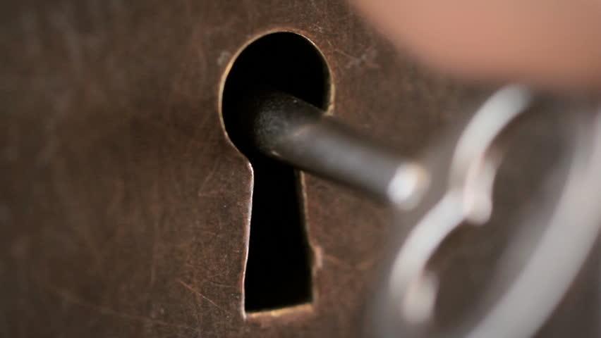 Skeleton key going into old keyhole lock