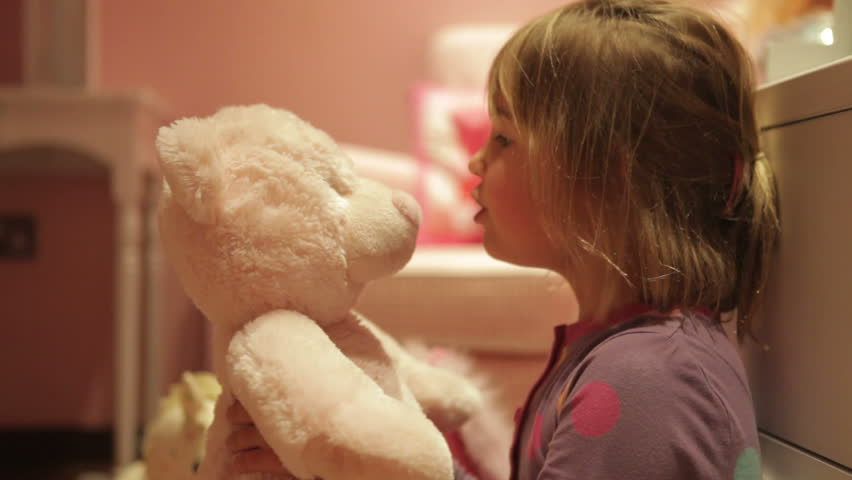 Girl talks to teddy bear before giving him big hug.Shot on Canon 5d Mk2 with a frame rate of 30fps
