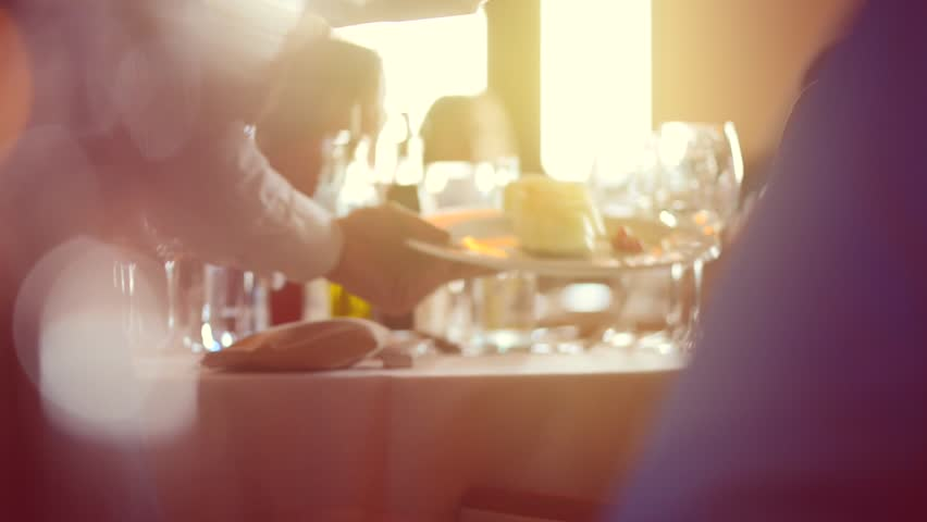 Dinner in a restaurant. Group of people eating and talking. Gourmet food - HD stock footage clip