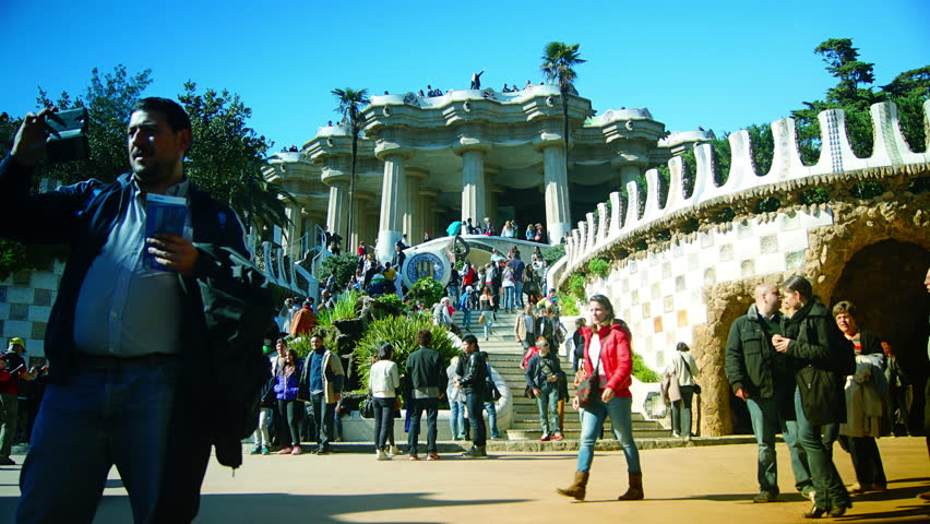 BARCELONA - MAR 07: A timelapse shot in Parc Guell, one of the city's major tourist attractions, with the urban skyline in the background, Barcelona, Spain. MAR 07, 2014. - 4K stock footage clip