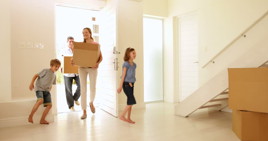 Happy family moving into their new home in their new home | Shutterstock HD Video #5932340