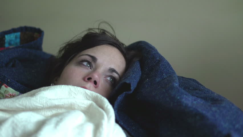 Sick girl laying on couch blows nose - HD stock footage clip