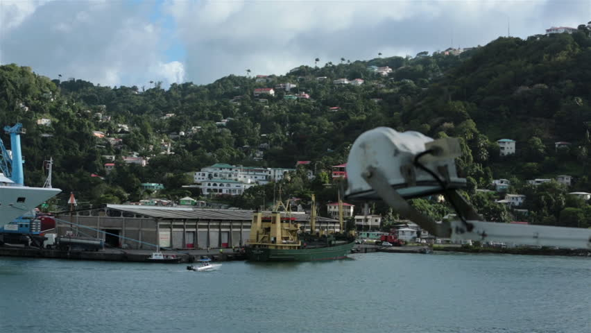 ST THOMAS - JAN 2014: St Lucia port harbor cruise ships urban city. Two luxury cruise ship in Castries port.  Foreign business investment in offshore banking and tourism industries is the island's main source of revenue.  - HD stock video clip