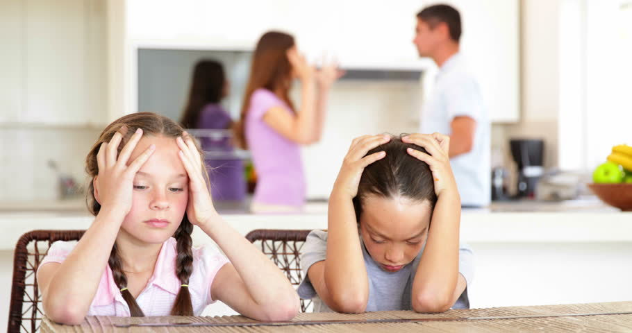 Sad children listening to their parents fighting at home in the kitchen - 4K stock video clip