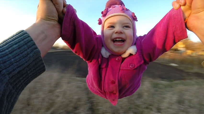 Slow Motion. Man Rotates His Little Daughter Outdoor, First Person View From