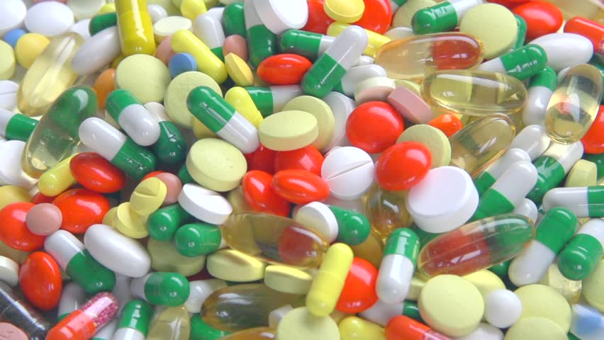 Medical pills falling down. Medicine concept. Treatment Many coloured capsules, pills fall and run around. Full HD slow motion 1080p