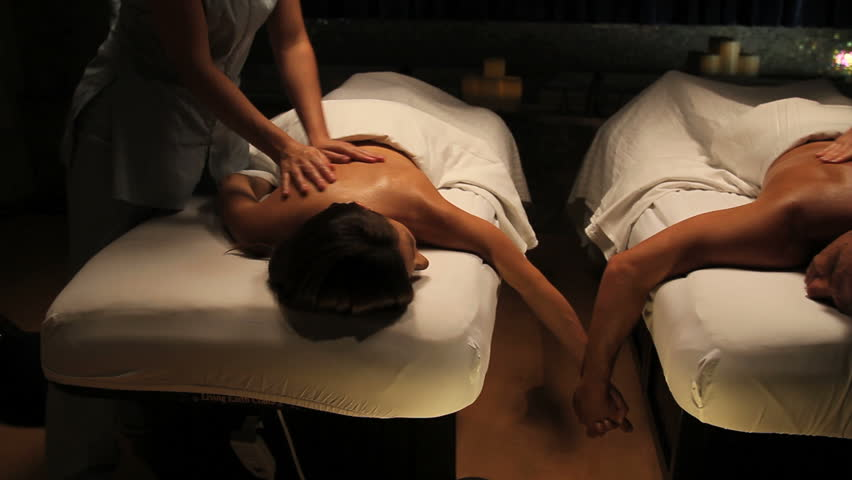 Tracking shot of couple getting massage in spa  | Shutterstock HD Video #5985530