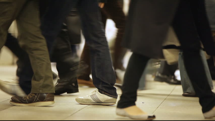 Crowd walking in subway hall in Kyoto, view on the shoes fashion diversity, Japan