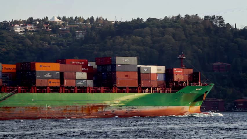 ISTANBUL - OCT 26, 2013: Large cargo ship MOZART (IMO: 9337274, Liberia) full of containers sails in Bosporus Sea. A 222 mt long, 30 mt width vessel, has a 33339 DWT.