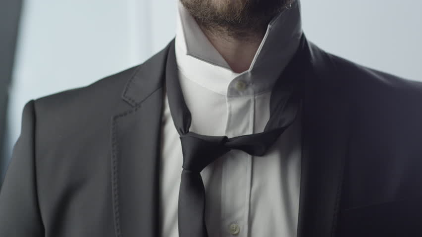 Man Tie a Necktie.
