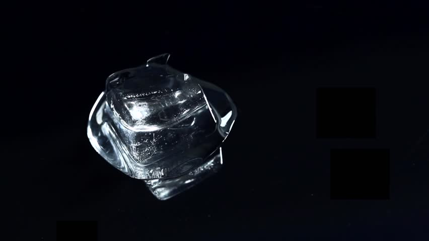 Time Lapse of  ice cube unmelting - HD stock footage clip