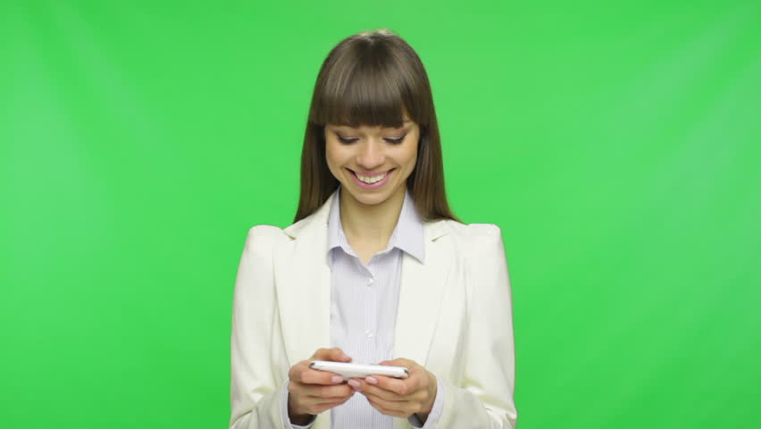 business woman using mobile cell phone type message touch screen, wear white suit, businesswoman think, got idea and smile over green screen chroma key background - HD stock video clip