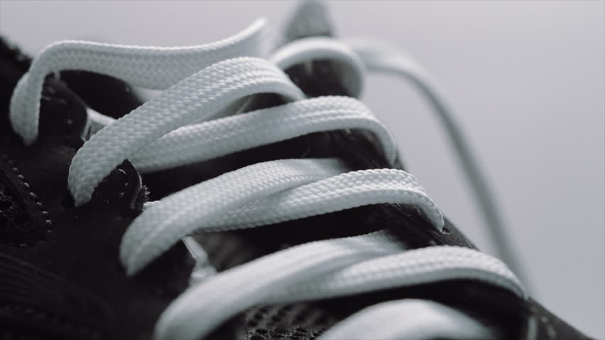 Trainer shoe or sneaker close up UHD stock footage. A close up dolly shot of a training shoe or sneaker filmed on the Arri Alexa in Ultra high definition 3840 x 2160.