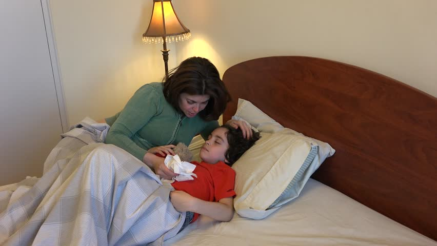Single Mother And Son Sleeping Together Or Sharing A Bedroom In An Apartment Or House Stock