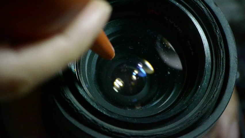 Manually clean camera lens. gh2_01147 - HD stock footage clip