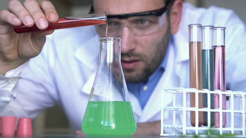 Pouring Mixing Chemicals In Erlenmeyer Flask Super Slow