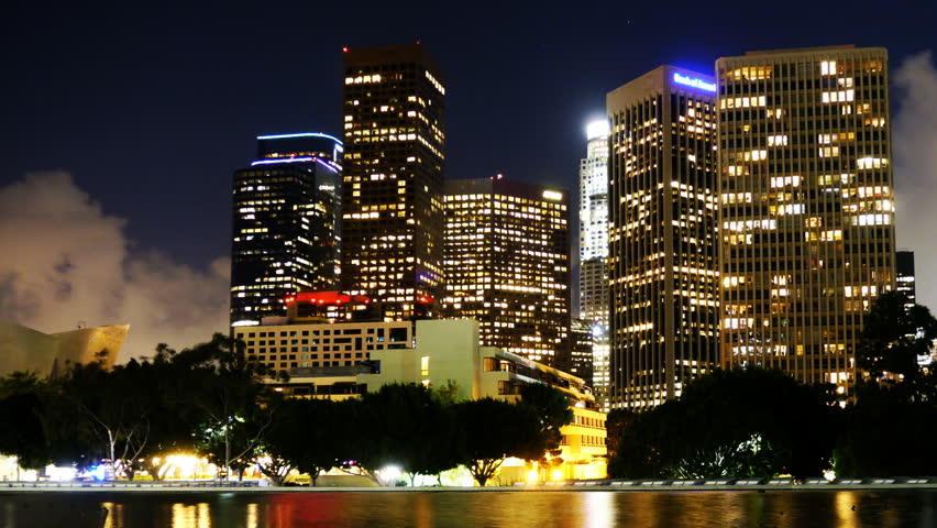 Time Lapse of Downtown Los Angeles with Water Reflection and Cloud Storm Rushing in at Night -Pan-