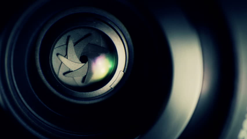 camera lens reflection macro with color lens flare stock