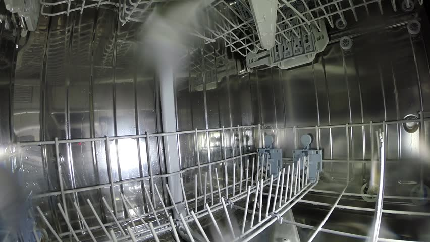 Dishwasher washes dishes glasses utensils clean and bright - an inside look. - HD stock video clip