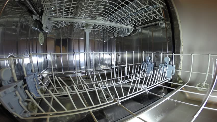 Dishwasher washes dishes glasses utensils clean and bright - an inside look. - HD stock footage clip