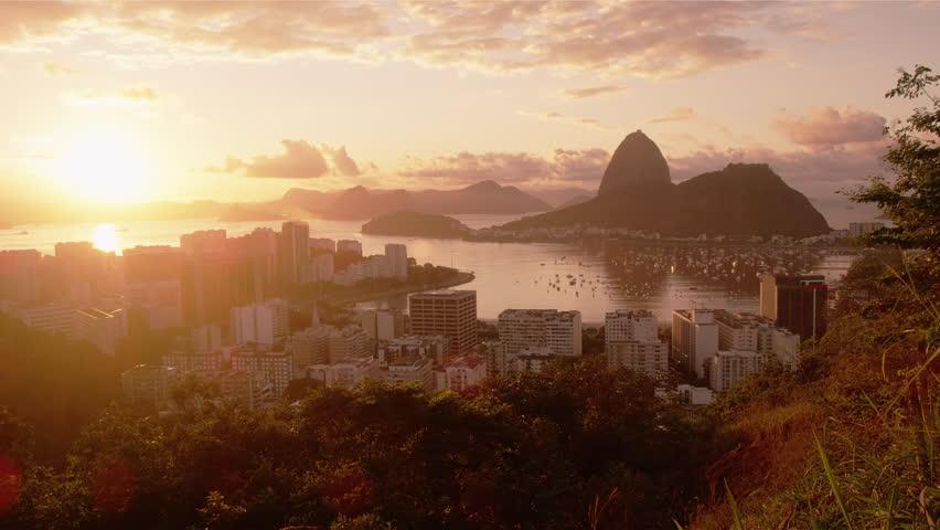 Tracking shot of Rio, Sugarloaf, sunshine, and Botafogo Bay.