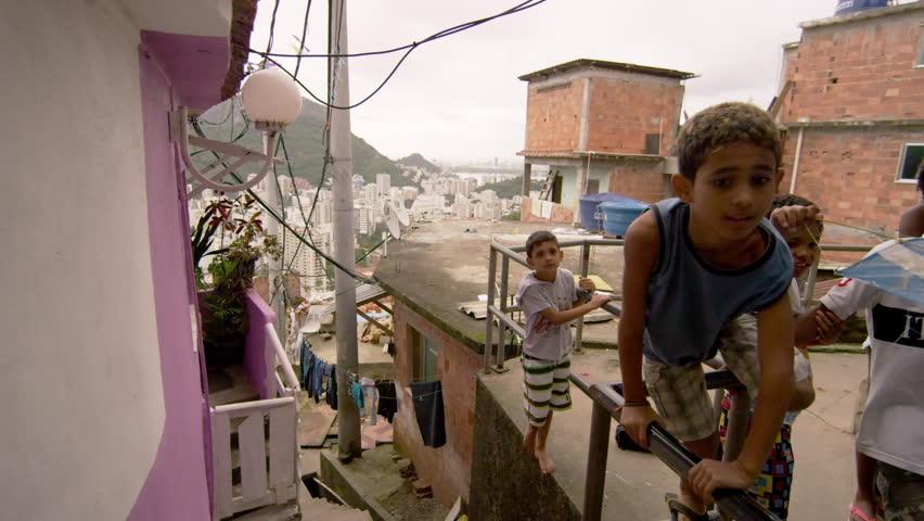 RIO DE JANEIRO, BRAZIL - JUNE 23: Slow dolly shot, favela occupants on Jun 23,