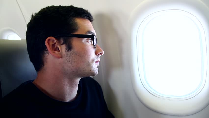 Plane Passenger looking through the Window.