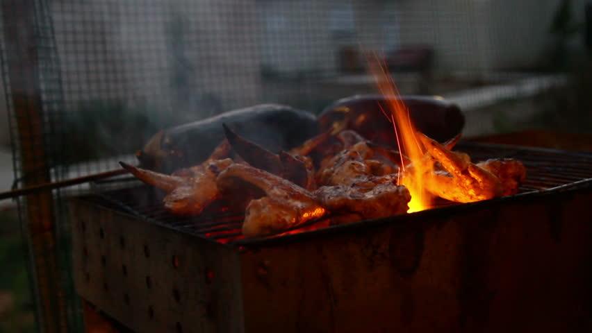 Tasty chicken on hot grill
