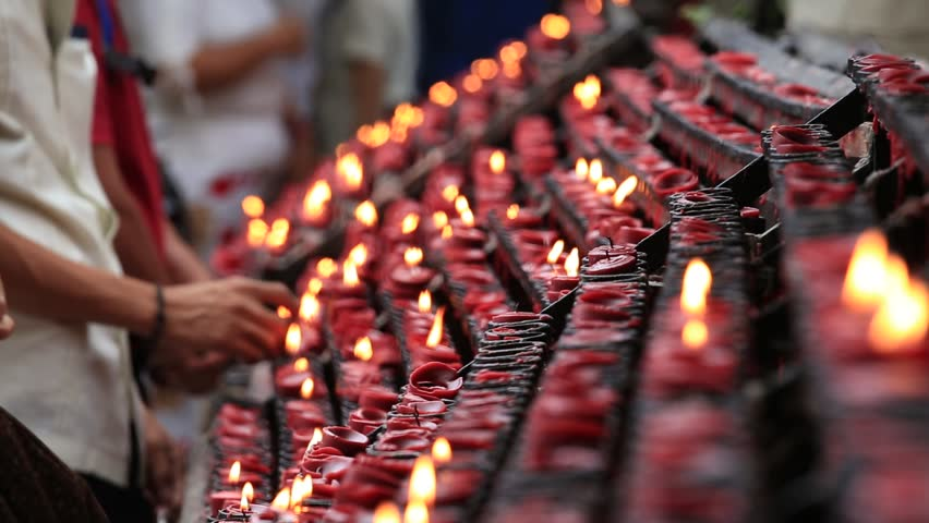 CEBU, PHILIPPINES - MARCH 14, 2014 : Unidentified people lit of candles in a old Catholic Church of the Basilica del Santo Niño in the Cebu, Philippines