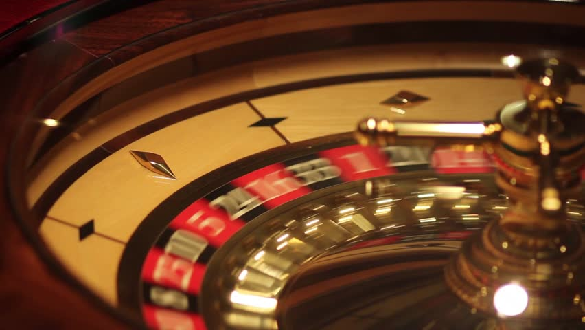 A shot of a casino roulette in motion,the ball stops at red thirty six/Better luck next time