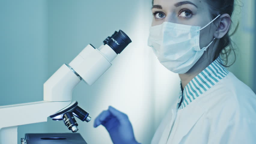 Doctor Does Research, Looking through Microscope.