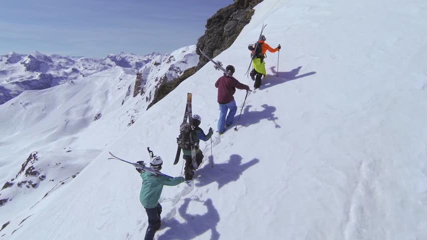 AERIAL: Skiers walking uphill