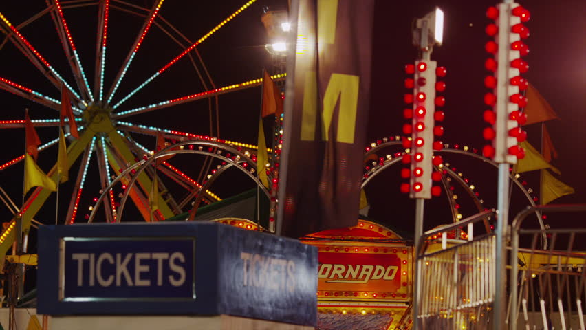 SALT LAKE CITY, UTAH, USA - July 18, 2013 - Medium shot of Ferris Wheel and amusement park at night  - HD stock footage clip